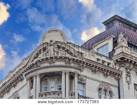 Historic building detail with dramatic  blue cloudy sky