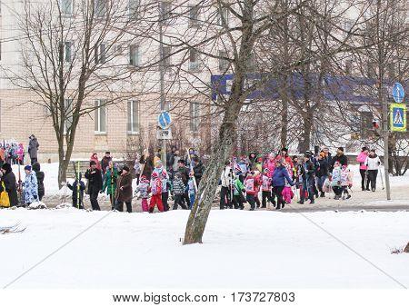Kirishi, Russia - 11 February, People walking across the street on a ski holiday, 11 February, 2017. Mass ski race Russian Ski Track.