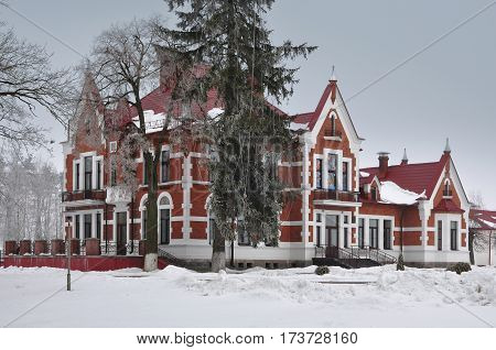Ancient homestead in Art Nouveau style in the village Golovichpole in the winter Grodno region, Belarus.