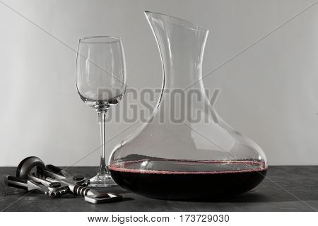 Glass carafe of red wine on gray table