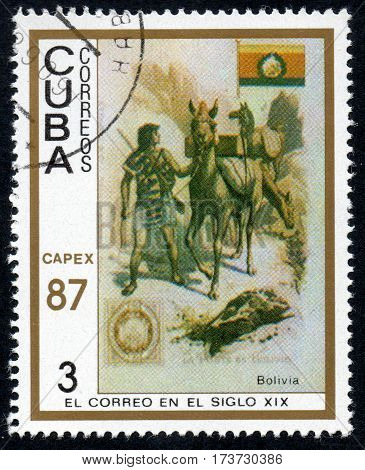 UKRAINE - CIRCA 2017: A stamp printed in Cuba shows a man leading a horse Bolivia the series The mail in the nineteenth century circa 1987