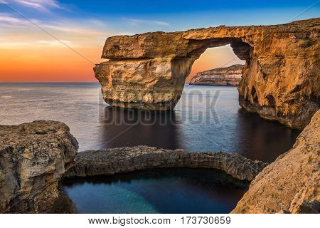 Gozo Malta - The beautiful Azure Window a natural arch and famous landmark on the island of Gozo at sunset