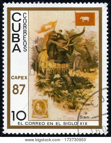UKRAINE - CIRCA 2017: A stamp printed in Cuba shows a man with a load moves on an elephant Siam the series The mail in the nineteenth century circa 1987