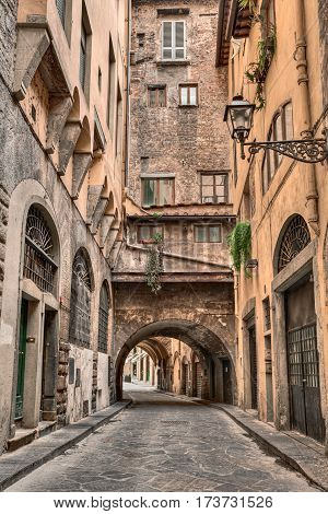 Florence, Tuscany, Italy: old narrow alley with underpass in the old town