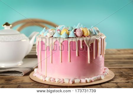 Beautiful Easter cake on wooden table
