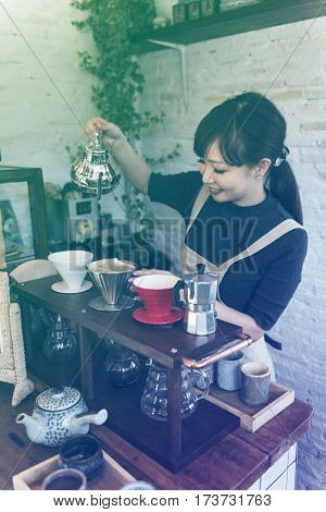 Photo Gradient Style with Woman Traditional Drinking Tea Relax in the Cafe