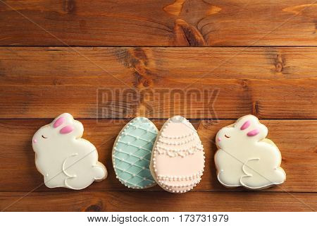 Creative Easter sugar cookies on brown wooden background