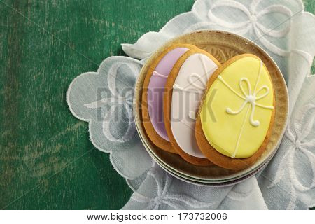 Easter sugar cookies on green wooden background