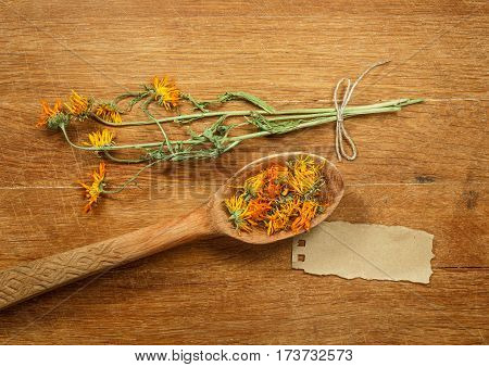Calendula. Dried herbs for use in alternative medicine spa herbal cosmetics herbal medicine preparing infusions decoctions tinctures powders ointments butter tea bath.