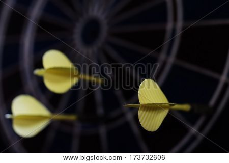 Darts, dartboard and three arrows, sports equipment