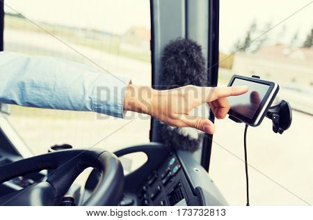 transport, transportation, tourism, navigation and people concept - close up of bus driver with gps navigator driving passenger bus