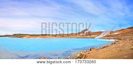 Panoramic View Of Geothermal Landscape With Beautiful Azure Blue Crater Lake, Myvatn Area, North Of