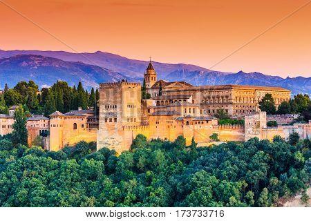 Granada, Spain. Alhambra fortress illuminated at sunset.