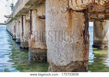 Dock concrete pillar on sea background close
