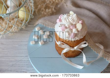 Tasty Easter cake on wooden stand