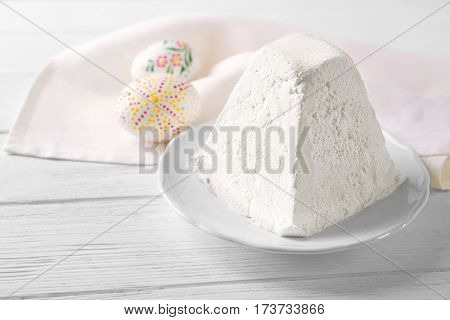 Plate with traditional Easter curd dessert on table