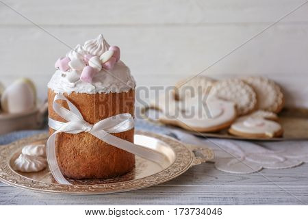 Tasty Easter cake with ribbon on tray