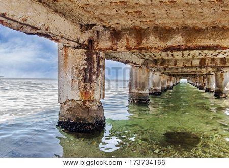 Dock concrete pillar under dock close up