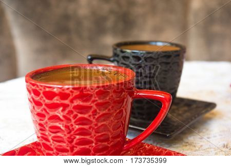 freshly brewed hot natural coffee with crema in black and red Cup poster