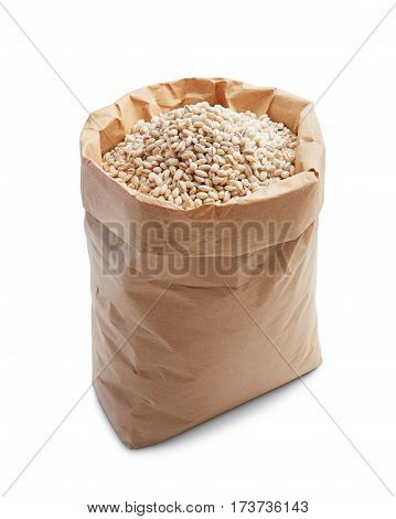pearl barley in paper bag isolated on white
