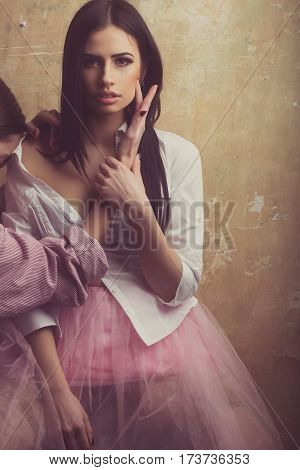 Pretty Sexy Woman In Pink Skirt On Textured Background