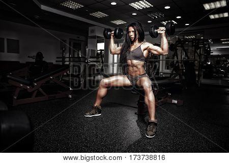 Sexy Fitness Woman In Sport Wear With Perfect Fitness Body In Gym Performing Shoulder Exercises With