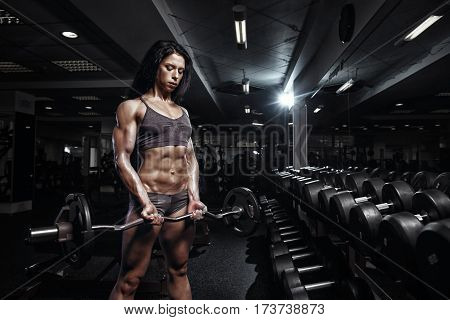 Sexy Fitness Woman In Sport Wear With Perfect Fitness Body In Gym Performing Biceps Exercises With E