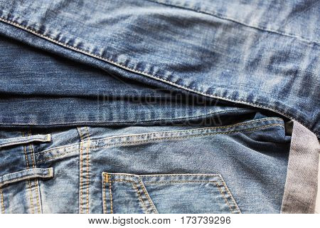 clothes, wear and fashion concept - close up of denim or jeans trousers