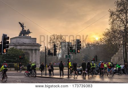 London, UK - December 6, 2016: Crowds of people commuting to work in london on bicycles and on foot