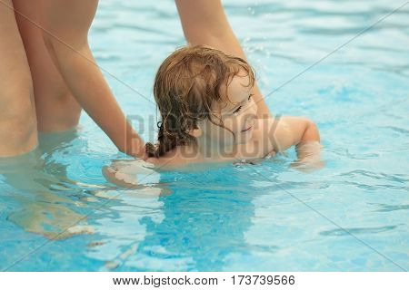 Cute Baby Boy Learns To Swim With Mothers Help