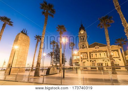 Adelaide Australia - August 22 2015: Moseley Square with Pioneer Memorial in the middle at night. Moseley Square is a public square in the City of Holdfast Bay at Glenelg