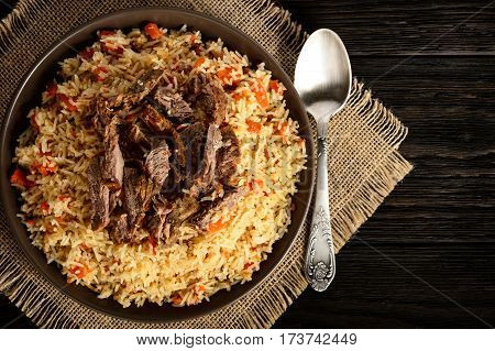 Pilaf- traditional asian dish, rice prepared with vegetables and meat.