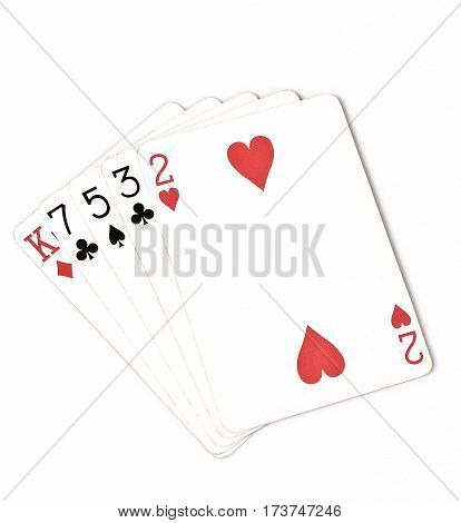 Poker hand ranking symbol set Playing cards in casino: hight hand King seven five three two on white background luck abstract horizontal copyspace close up on white