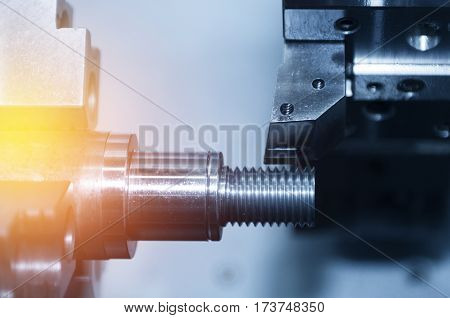 The CNC lath or CNC Turning machine cutting the thread with the abstract lighting effect scene