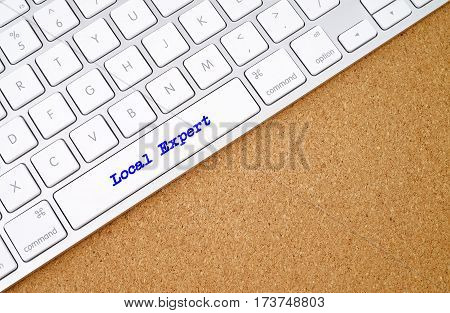 Local Expert on computer keyboard background with copyspace area.