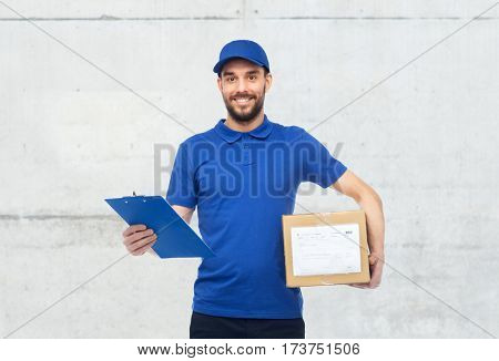 delivery service, mail, logistics, people and shipping concept - happy man with parcel box and clipboard over gray concrete wall background