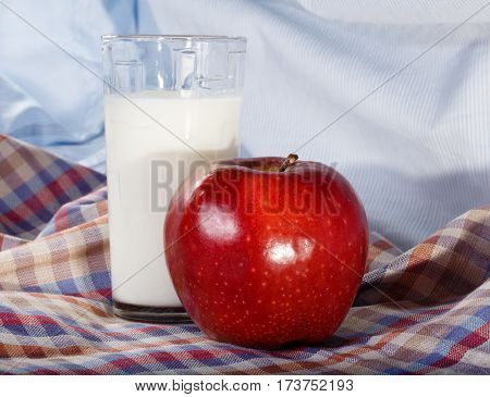 Healthy lifestyle. Milk in the glass and red apple