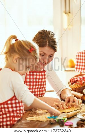 Mum and daughter baking cakes. Making cookies.
