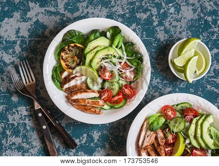 Roasted chicken avocado and fresh vegetable salad. Healthy food concept