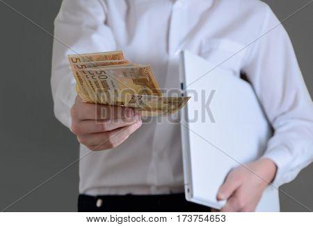businessman giving euro money