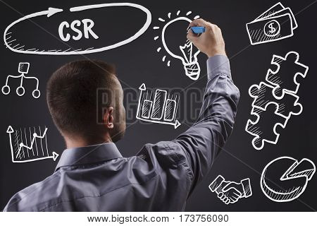 Technology, Internet, Business And Marketing. Young Business Man Writing Word: Csr