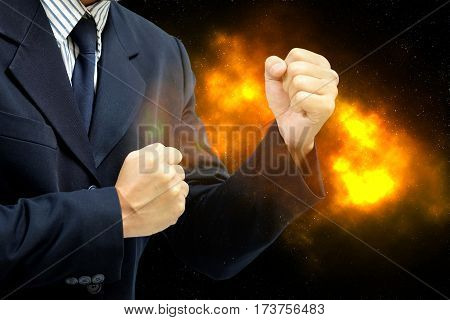 Business Man wearing a suit fists ready to fight. The concept of business competition is fierce as fire.