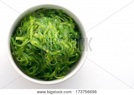 Hiyashi Wakame Chuka or seaweed salad in bowl on white background Japanese food