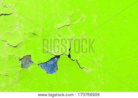 Peeling paint of green and purple colors on the stone texture background - texture of peeling paint. Texture background of peeling paint