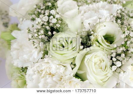 Bouquet Floral arrangement white roses carnation and gypsophila paniculata for Valentine's Day white and green tone