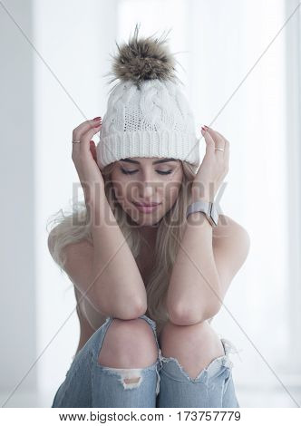 Happy woman in underwear and funny hat with bubon.