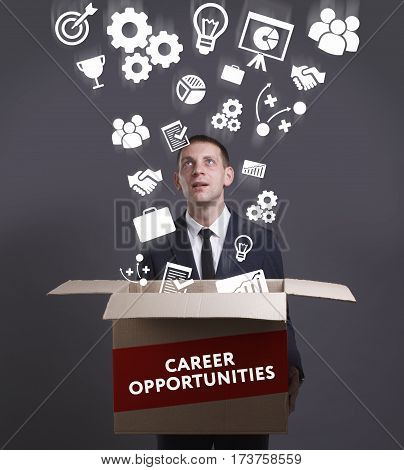 Business, Technology, Internet And Network Concept. Young Businessman Shows The Word: Career Opportu