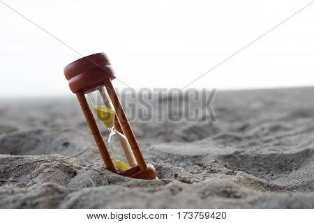 Wooden Sand Clock Put On Beach Background
