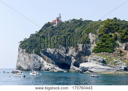 Tino island (Portovenere) Italy - 7 July 2015: people on their boats were moored at island of Tino near Portovenere italy