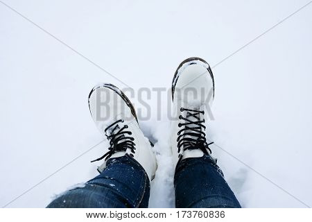 Foot Of Woman With Blue Jean Pants Standing In Snow